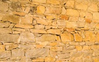 Mur ancien en pierre sèches